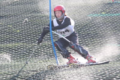 skier racing through gates