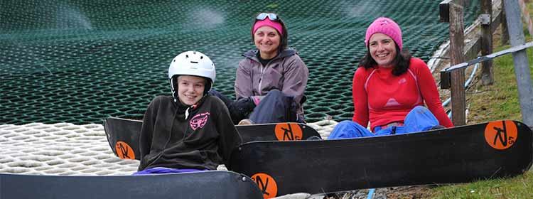 sitting snowboarders taking time out